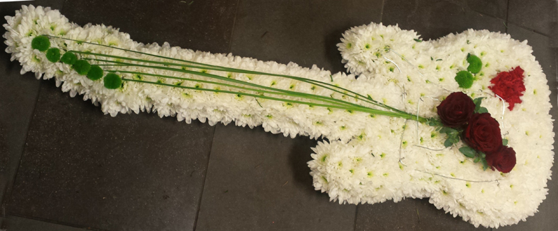 Guitar made of flowers as funeral tribute